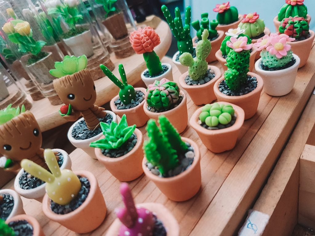 small handmade sculptures of succulent plants that is being sold at a unique market in Thailand