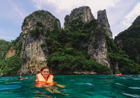 woman swimming by the beautiful ocean of Phi Phi island