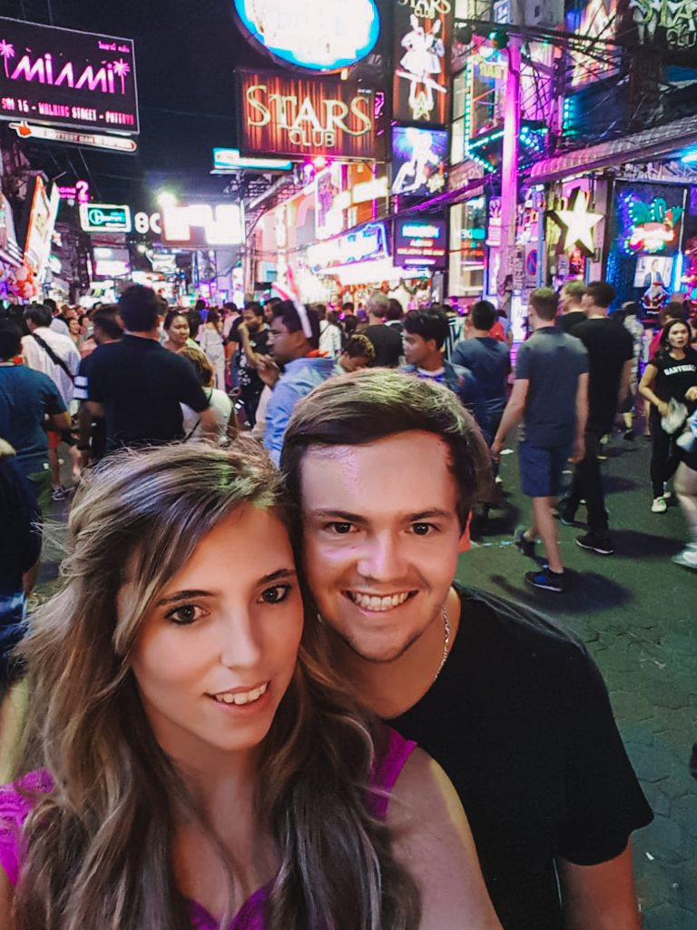 Chane and Jonathan surrounded by the people in the walking street of Pattaya.