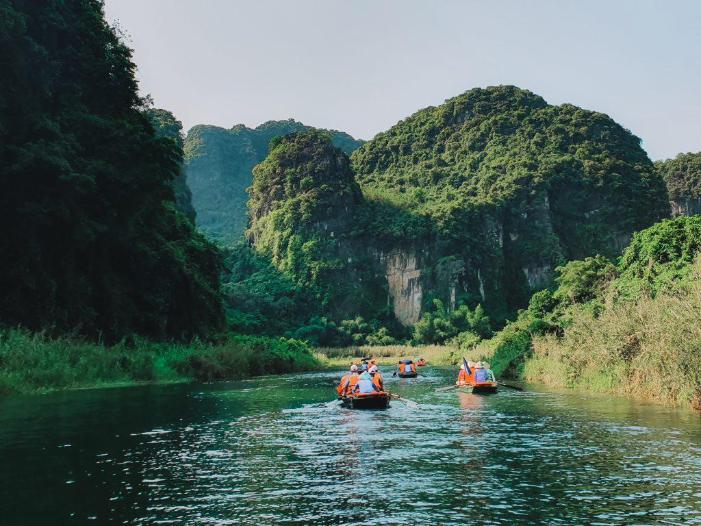 Trang An a river running through the limestone mountains