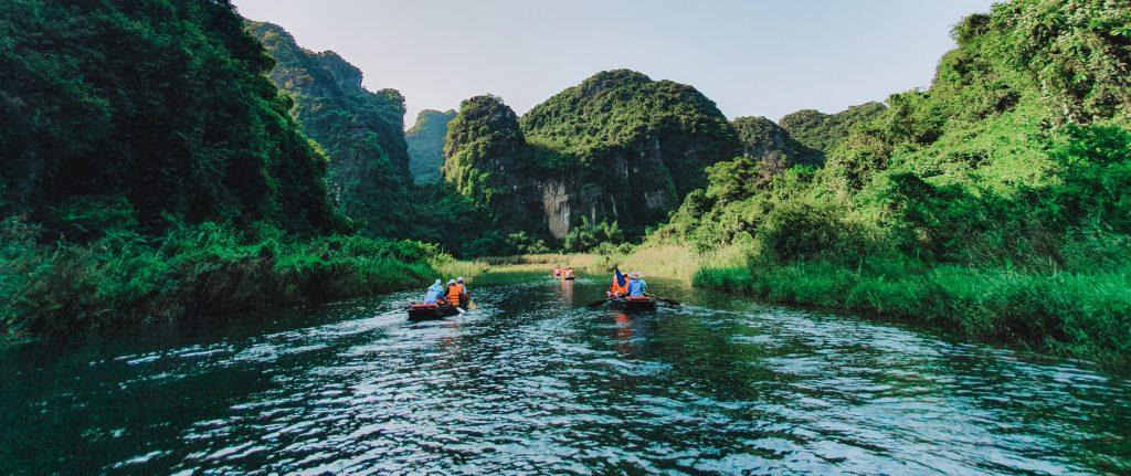 Kayaking in the Trang An river in Vietnam