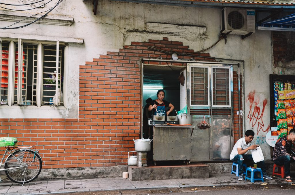 lady cooking food in Vietnam