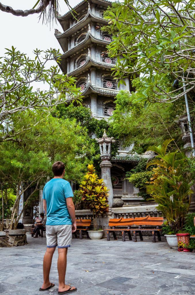 Jonathan looking at a pagoda on Marble mountain