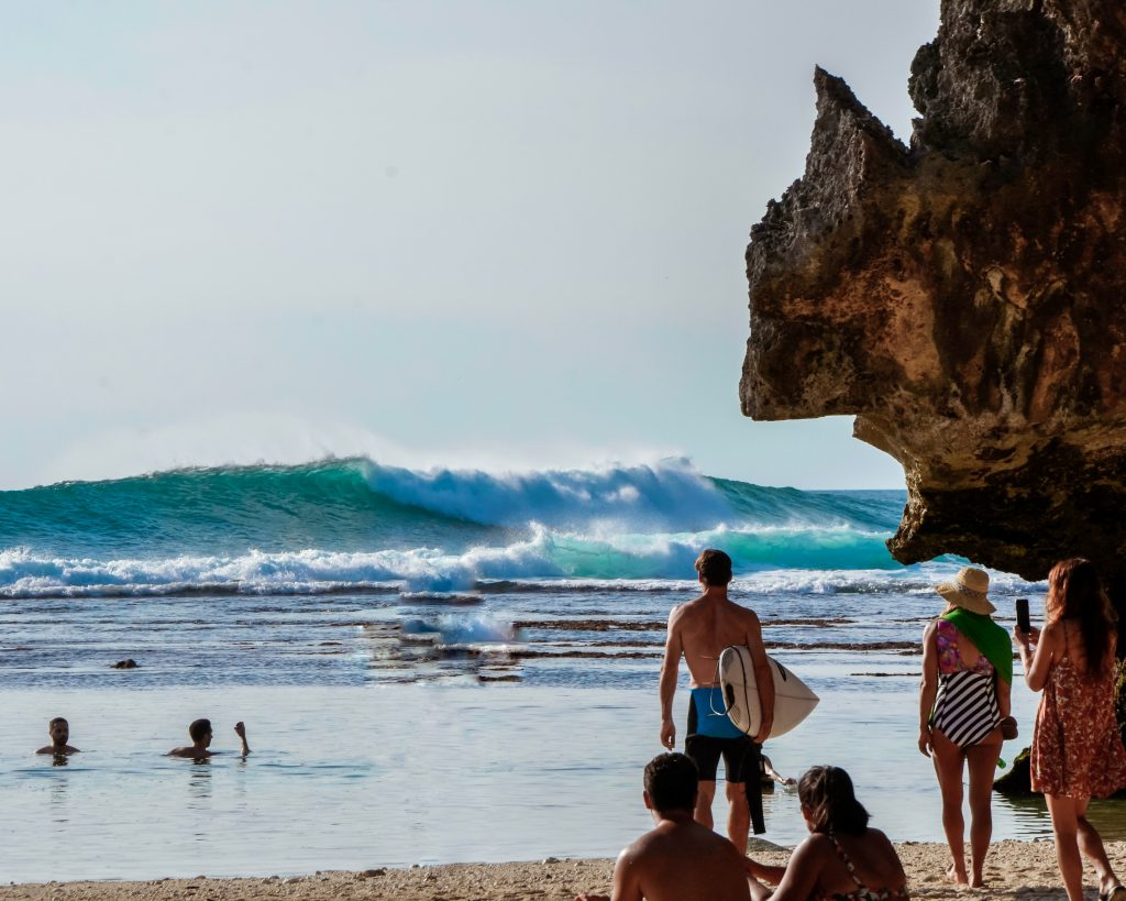 surfing at Suluban Beach of Bali