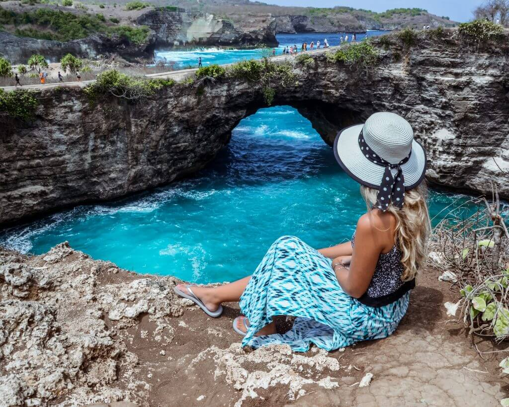 Chane looking out at broken beach on Nusa Penida Island, Indonesia