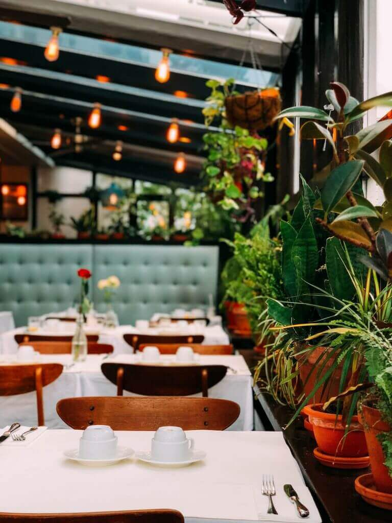 a beautiful decorated restaurant that has a very warm and comfortable feeling