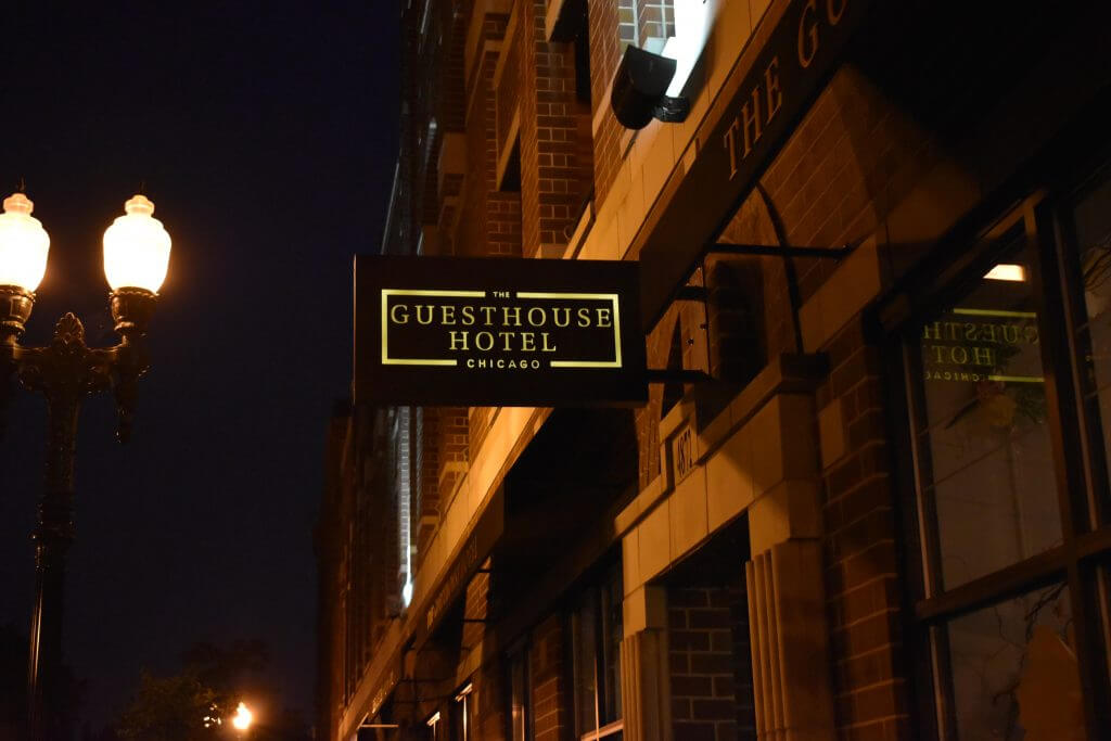 a beautiful sign on the outside of a hotel and guesthouse